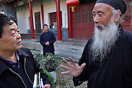 Tao Grand Master Rinfarong, explains about Taoism for us, at the Louguantai temple, Xian, Shaanxi, China. This temple is where Lao Tze wrote the basics of the Tao/Dao faith.