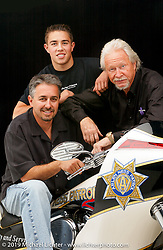 Arlen Ness with his son Cory on Ness Patrol custom bagger and grandson Zach in the background. 2004. Photography ©2004 Michael Lichter.