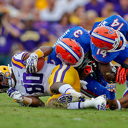 Oct 12, 2013; Baton Rouge, LA, USA; Florida Gators linebacker Antonio Morrison (3) and defensive back Jaylen Watkins (14) tackle LSU Tigers wide receiver Jarvis Landry (80) during the second half of a game at Tiger Stadium. LSU defeated Florida 17-6. Mandatory Credit: Derick E. Hingle-USA TODAY Sports