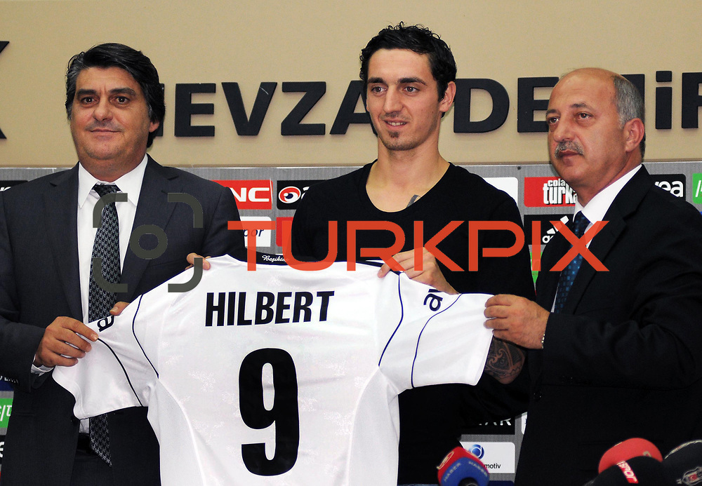 Turkish soccer team Besiktas's new player German Roberto HILBERT (C) poses for media with his new jersey after the signing ceremony in Istanbul, Turkey on 22 June 2010. Besiktas signed a contract with Roberto HILBERT for three years. Photo by TURKPIX