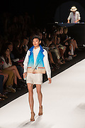 Short white shorts, a white blouse with Peter Pan collar and a vest transitioning from electric blue to muted salmon.