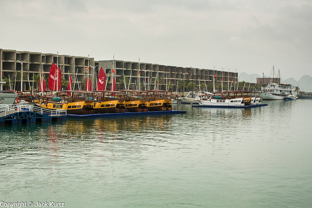 04 APRIL 2012 - HA LONG, VIETNAM:   An exclusive condominium development in Ha Long City on Ha Long Bay with slips for boats. In 1994 UNESCO declared 174 square miles of Ha Long Bay a World Heritage Site. There are nearly 2000 distinct rock islands in the bay, which for centuries has been the home to isolated fishing villages. Now thousands of tourists stream through the bay and around the islands every day on cruise ships. On the Vietnamese mainland, around the town of Ha Long, real estate companies are developing exclusive condominium and apartment complexes for use as weekend homes for people in Hanoi, about a 3.5 hour drive from Ha Long.      PHOTO BY JACK KURTZ