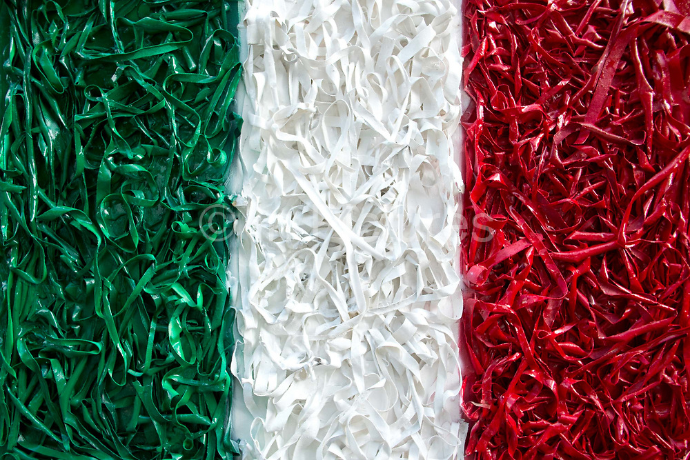 Italy flag art piece, made from dried pasta and painted.