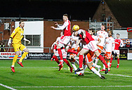 Blackpool clear a corner during the EFL Sky Bet League 1 match between Fleetwood Town and Blackpool at the Highbury Stadium, Fleetwood, England on 25 November 2017. Photo by Paul Thompson.