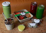 """A sample of healthy foods sold at the Source Juicery include, clockwise from front center: a """"Hot Shot"""" combo of ginger, lemon and honey; for breakfast try this cup of overnight oats, gluten-free oats, chia, almond milk, pure maple syrup, pecans, blueberries and cinnamon; """"Green Goddess"""" power smoothie made from kale, avocado, mango, peach, strawberries, apple juice, protein powder, low-fat vanilla bean and Greek yogurt; the seasonal """"Detox Salad"""" has black kale, red bell pepper, navel orange slices, raw walnuts, carrots and pomegranate seeds, with a lemon-vinaigrette dressing; the """"Up Beet"""" drink is a mix of beet, carrot, apple, orange, turmeric, ginger and lemon; the """"Clean Green"""" drink contains kale, spinach, cucumber, celery, parsley and lemon; and finally, there are """"Power Bites"""" -- shown are the Dark Chocolate Chia and the Thai-spiced Peanut varieties."""
