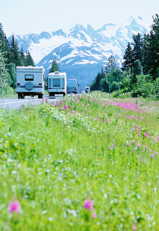A line of RVs and cars headed south on Highway 1, the Seward Anchorage Highway, Alaska, USA.