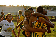 Liberty High School's student athletes rejoice after their boys team won the Orange Belt Conference Track and Field Championship on Thursday, April 7, 2011 at St. Cloud High School.