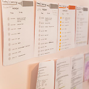 Brooklyn's class schedule hangs on her bedroom wall.  She attends virtual school from her bedroom.