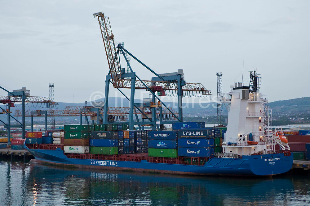 Container ship being loaded with containers at Belfast Docks, Northern Ireland, United Kingdom.