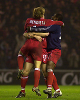 Photo. Glyn Thomas.<br /> Middlesbrough v Everton. Carling Cup Round 4.<br /> Riverside Stadium, Middlesbrough. 03/12/2003.<br /> Boro Mendieta leaps high as he is congratulated by teammates after scoring his side's winning penalty.