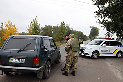 October 9, 2018 - Chernihiv Region, Ukraine - Police officers man a roadblock set up in the area affected by the fire and explosions at the ammunition depot of À1479 military base near Ichnia, Chernihiv Region, northern Ukraine, October 9, 2018..Ukrinform..CHERNIHIV REGION. At 3:30 am local time, a fire and a series of explosions shook the warehouses of À1479 military base near Ichnia in Chernihiv Region. Almost 12,000 local residents have been evacuated. No injured have been reported. The airspace over the area has been closed off and road and rail transport has been suspended. The emergency response headquarters have been set up to counter the incident. (Credit Image: © Tarasov/Ukrinform via ZUMA Wire)