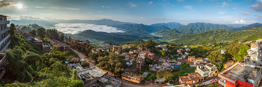 Panoramic view of Tensen Valley's White lake formed by low morning clouds in the green Himalayan Valley.