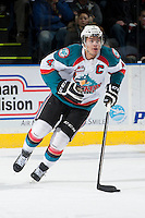 KELOWNA, CANADA - MARCH 22: Madison Bowey #4 of the Kelowna Rockets skates against the Tri-City Americans on March 22, 2014 during game 1 of the first round of WHL Playoffs at Prospera Place in Kelowna, British Columbia, Canada. Bowey is a 2013 NHL entry draft pick of the Washington Capitals. (Photo by Marissa Baecker/Getty Images)  *** Local Caption *** Madison Bowey;