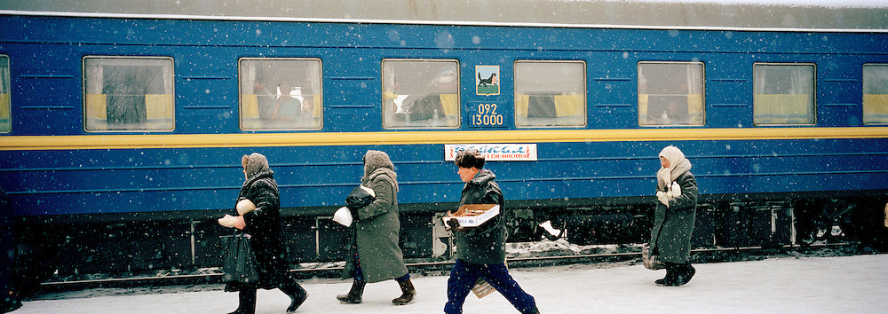 Locals selling produce to travellers on the Trans Siberian Railway, Siberia, Russia