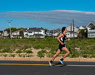 Spring Lake, NJ USA -- May 27, 2017 Runner takes an early lead in the annual Spring Lake 5 mile race. Editorial Use Only.
