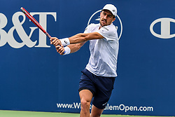 August 21, 2018 - Winston-Salem, NC, U.S. - WINSTON-SALEM, NC - AUGUST 21: Steve Johnson (USA) returns a volley against Tommy Paul (USA) during the Winston-Salem Open on August 21, 2018 at the Wake Forest Tennis Center in Winston-Salem, North Carolina. (Photo by William Howard/Icon Sportswire) (Credit Image: © William Howard/Icon SMI via ZUMA Press)