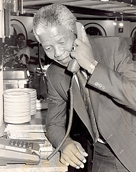 Nelson Mandela on the telephone in a kitchen, Cape Town in 1990.