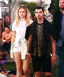Couple Joe Jonas and Sophie Turner were spotted hanging out with Nick Jonas and his mystery date at Coachella 2017 in Indio, California. The brothers and their girls were seen mingling with fans and friends as they enjoyed drinks and Lady Gaga on stage. 16 Apr 2017 Pictured: Sophie Turner, Joe Jonas. Photo credit: Marksman / MEGA TheMegaAgency.com +1 888 505 6342