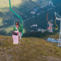 A tourist rides a chairlift near Elbrus, in the Russian Caucuses.