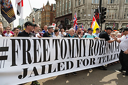 """Demonstrators gather at Oxford Circus as several hundred protesters in London in central London demand the release of """"political prisoner"""" right wing talisman Stephen Yaxley-Lennon  - also known as Tommy Robinson, who was imprisoned for contempt of court. London, August 03 2019."""