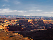 The sunset view looking southwesterly from Murphy Hogback, along the White Rim Road, Island in the Sky District, Canyonlands National Park, Moab, Utah, USA.