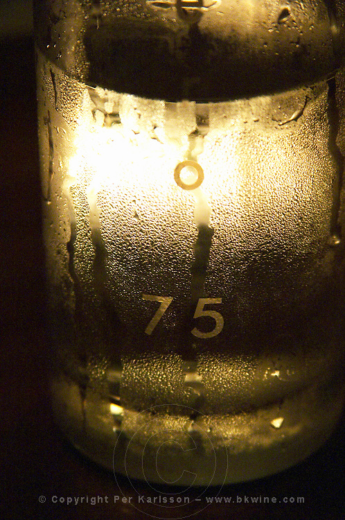 In the restaurant Number 75 in Avignon,, a water carafe with water beads with the name of the restaurant, back lit by a candle. Avignon, Vaucluse, Provence, Alpes Cote d Azur, France, Europe