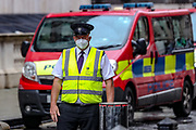A security guard is seen wearing a face mask in front of The Foreign and Commonwealth Office in central London on Thursday, June 18, 2020, prior to a visit of the French President Emmanuel Macron to Britain. For his first foreign trip since lockdown, Emmanuel Macron will be in London to mark the 80th anniversary of de Gaulle's « appel de Londres », as well as cement Franco-UK ties at a strained time due to Brexit. A joint French and British jet flypast is announced to be performed at 5pm. (Photo/ Vudi Xhymshiti)