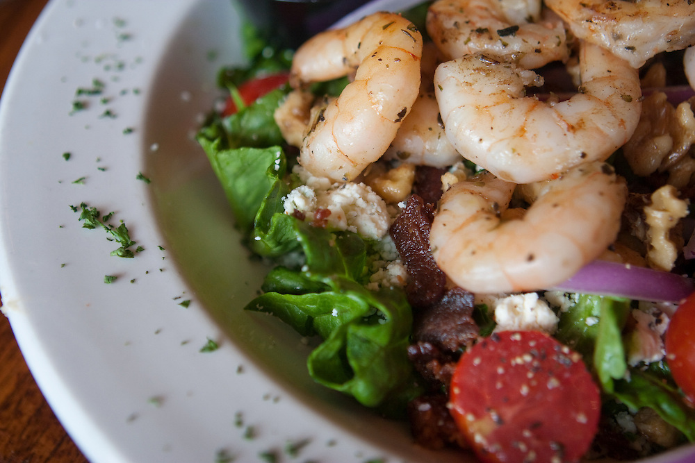 Shrimp creole salad with bacon and warm bleu cheese, over spring greens.