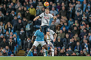 Eric Dier (Tottenham Hotspur) heads the ball clear during the Barclays Premier League match between Manchester City and Tottenham Hotspur at the Etihad Stadium, Manchester, England on 14 February 2016. Photo by Mark P Doherty.