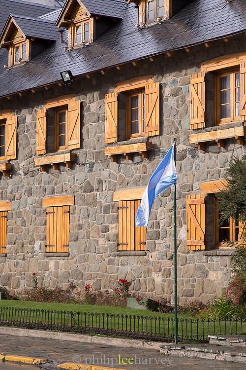 View of Civic Centre (Centro Civico) with Argentinian flag and main square in downtown Bariloche City, San Carlos de Bariloche, Argentina