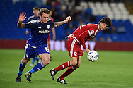 Aron Gunnarsson of Cardiff city (l) challenges Diego Fabbrini of Middlesbrough .Skybet football league championship match, Cardiff city v Middlesbrough at the Cardiff city Stadium in Cardiff, South Wales  on Tuesday 20th October 2015.<br /> pic by  Andrew Orchard, Andrew Orchard sports photography.