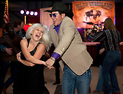 PRICE CHAMBERS / NEWS&GUIDE<br /> Taryn Postma spins on the dance floor with Jesse Cornett at the 40th annual Fireman's Ball on Saturday night at the Heritage Arena.