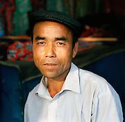 Portrait of market worker, Silk Route, Turpan, Xinjiang Province, China.