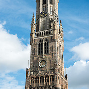 The tower of the Belfry in the Markt (Market Square) in the historic center of Bruges, a UNESCO World Heritage site.