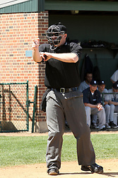 14 April 2013:  Home Plate umpire Steve Jones calls a strike during an NCAA division 3 College Conference of Illinois and Wisconsin (CCIW) Baseball game between the Elmhurst Bluejays and the Illinois Wesleyan Titans in Jack Horenberger Stadium, Bloomington IL