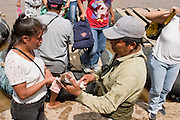27 JULY 2004 --  TAPACHULA, CHIAPAS, MEXICO: People from Guatemala pay the rafters who brought them across the Rio Suchiate to the Mexican town of Hidalgo, near Tapachula. Tapachula is center of the smuggling industry between Mexico and Guatemala. Consumer goods are smuggled south to Guatemala (to avoid paying Guatemalan import duties) and people are smuggled north into Mexico. Most of the people coming north are hoping to eventually get to the United States.  PHOTO BY JACK KURTZ