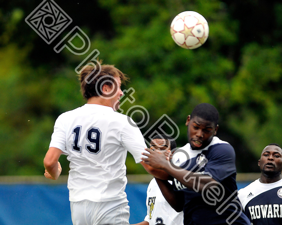 2011 September 25 - FIU's Arnthor Kristinsson (16) head butting the ball. Florida International University men's soccer team took on Howard University at FIU Soccer Field. The game was cancelled at the half due to in climate weather. FIU was leading 2-1 at the half. (Photo by: www.photobokeh.com / Alex J. Hernandez)
