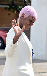 Susan Okoya, 44, leaving Camberwell Green Magistrates' Court in London, where she was accused of breaching a restraining order by contacting former Manchester United and England footballer Rio Ferdinand.