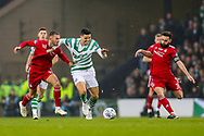 Tomas Rogic (#18) of Celtic battles to retain possession against Dominic Ball (#21) of Aberdeen and Graeme Shinnie (#3) of Aberdeen during the Betfred Cup Final between Celtic and Aberdeen at Celtic Park, Glasgow, Scotland on 2 December 2018.