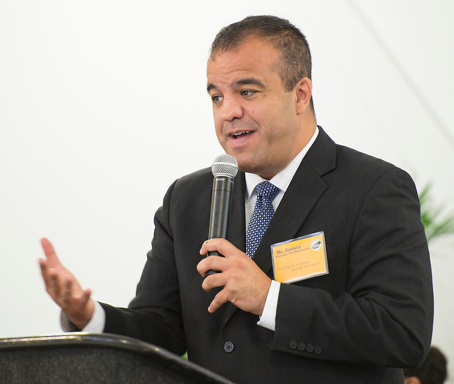 Principal Eduardo Sindaco comments during The Rusk School ribbon cutting ceremony, April 7, 2014.