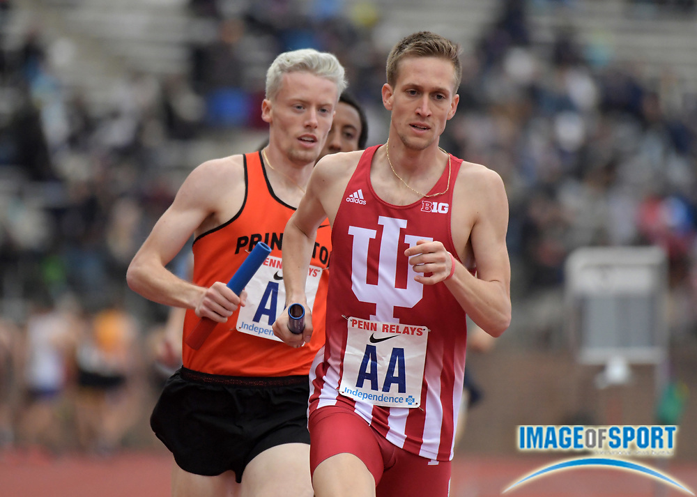 Apr 27, 2018; Philadelphia, PA, USA; Joseph Murphy of Indiana leads the 1,600m anchor leg in the Championship of America distance medley relay during the 124th Penn Relays at Franklin Field. Indiana placed fourth in 9:36.89.