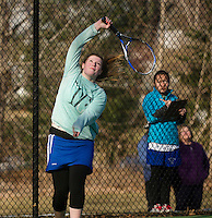 Gilford's Kayla Vieten makes an over hand shot during her singles match with Emily Haight of Interlakes on Wednesday afternoon.  (Karen Bobotas/for the Laconia Daily Sun)
