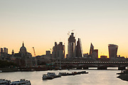 View from Waterloo Bridge over River Thames at sunrise, London, England, UK