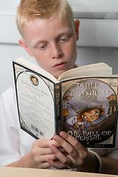 Teenager boy reading,