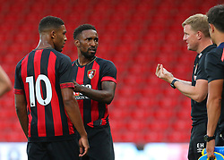 Bournemouth's Jermain Defoe and Jordon Ibe receive instructions from manager Eddie Howe during the pre-season friendly at the Vitality Stadium, Bournemouth.