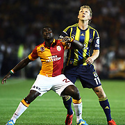 Fenerbahce's player Dirk Kuijt (R) and Galatasaray's Emmanuel Eboue in action during their Turkish Super Cup 2012 soccer derby match Galatasaray between Fenerbahce at the Kazim Karabekir stadium in Erzurum Turkey on Sunday, 12 August 2012. Photo by TURKPIX