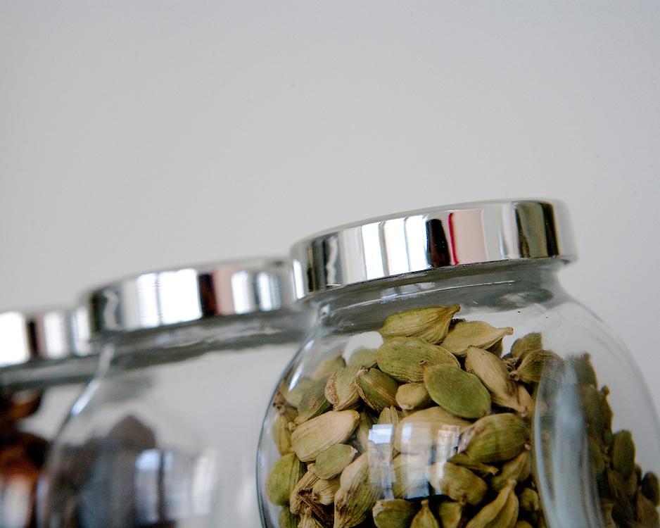 Still lify study of glass jars with cardamon