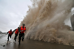0565014  <br /> Frontier defence soldiers encounter high waves caused by Typhoon Fitow in Wenling City, east China s Zhejiang Province, Oct. 6, 2013. China s meteorological authority issued a red alert on Sunday as Typhoon Fitow approaches the country s southeast coastal areas, October 06, 2013. Picture by imago /  i-Images<br /> UK ONLY