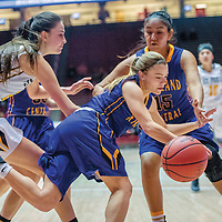 Kirtland Central Bronco Peanut Dryden (2), center, dives for a loose ball around  St. Pius X Sartan Arianna Martinez (23), left, and Bronco Aubrey Thomas (15) in a District 5A quarterfinal at The Pit in Albuquerque Tuesday.
