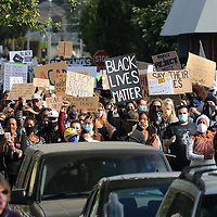 Black Lives Matter signs filled the air as Juneteenth marchers made their way up Center Street from Louden Nelson Community Center to Santa Cruz City Hall on Friday. (Shmuel Thaler — Santa Cruz Sentinel)